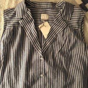 Sleeveless button down, blue and white striped.